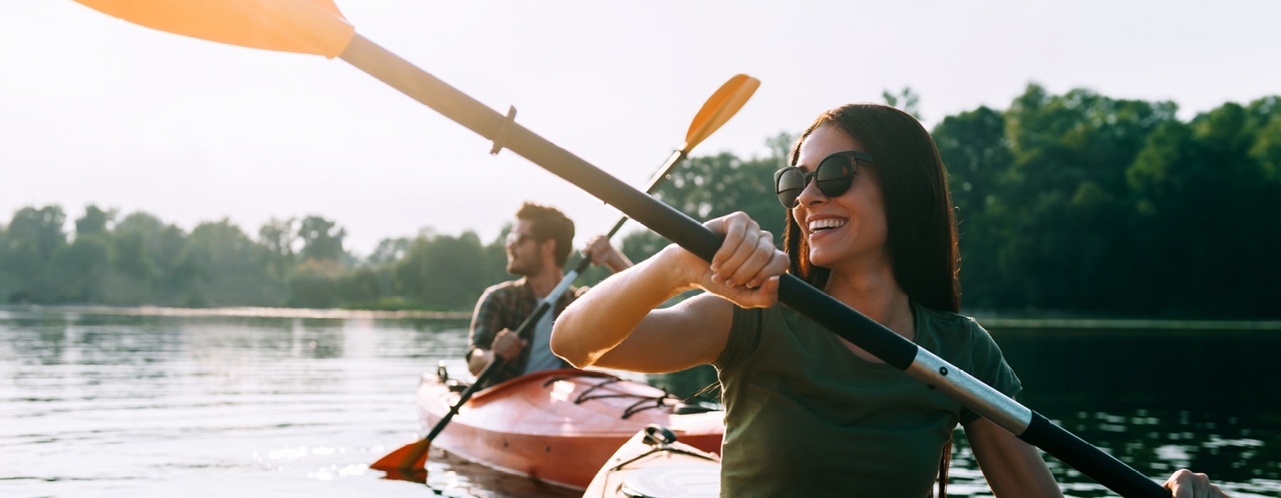 young couple kayaking on the river